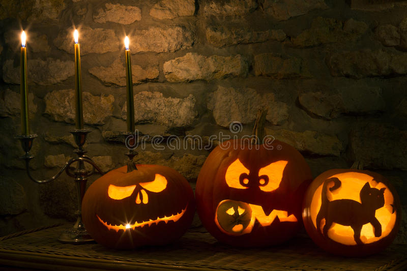 Halloween Pumpkins - Jack OLantern. Spooky Halloween pumpkins - the night of 31st October, the eve of All Saints Day, often celebrated by children dressing up in royalty free stock images