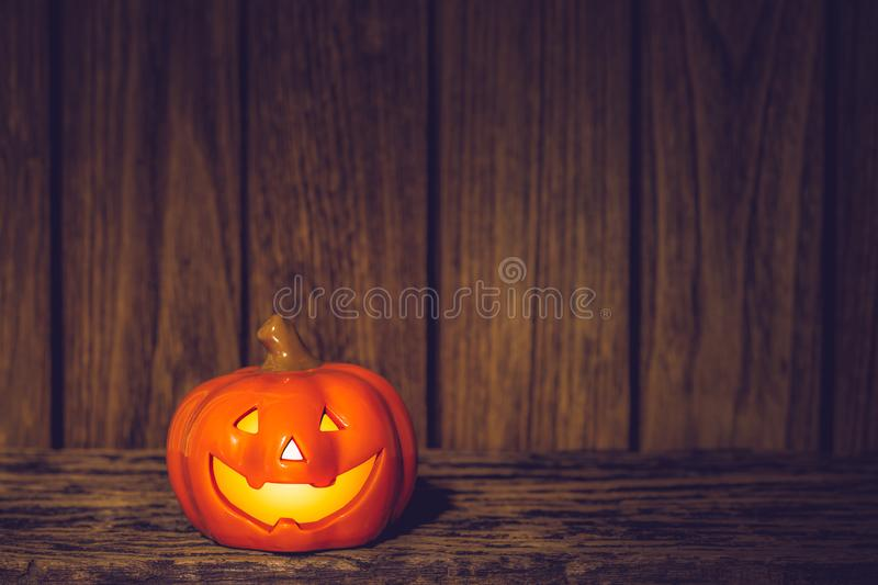 Halloween Pumpkins  jack o lanterns with funny faces on grunge wood at night. Halloween background with copy space for your. Advertisement text, autumn stock image