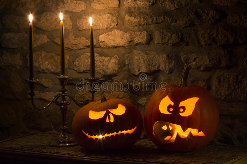 Halloween Pumpkins - Jack OLanterns. Spooky Halloween pumpkins - the night of 31st October, the eve of All Saints Day, often celebrated by children dressing up stock photography
