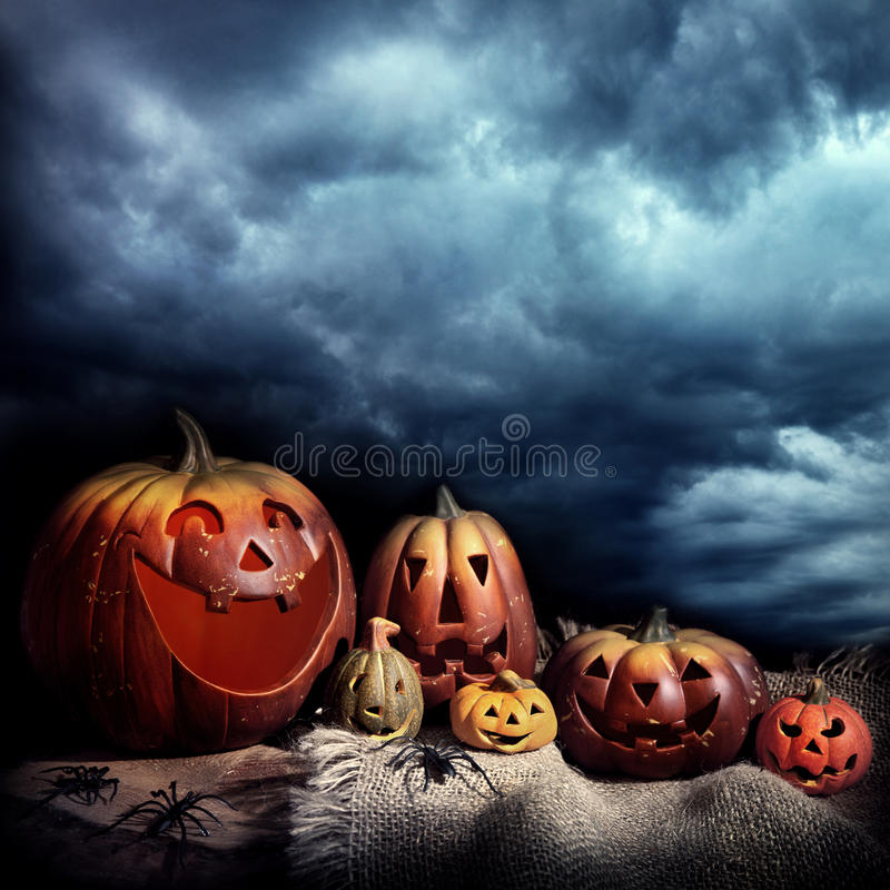 Halloween pumpkins at night royalty free stock photos