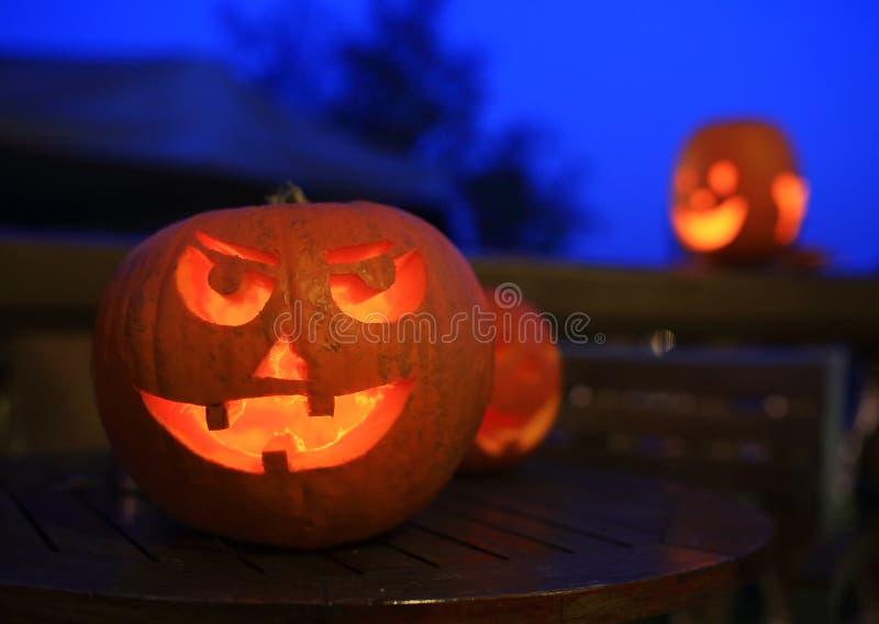 Halloween pumpkins at night. Funny halloween pumpkins at night stock photography