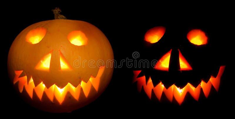 Halloween pumpkins in the night. Nice halloween pumpkins on the black background stock photo