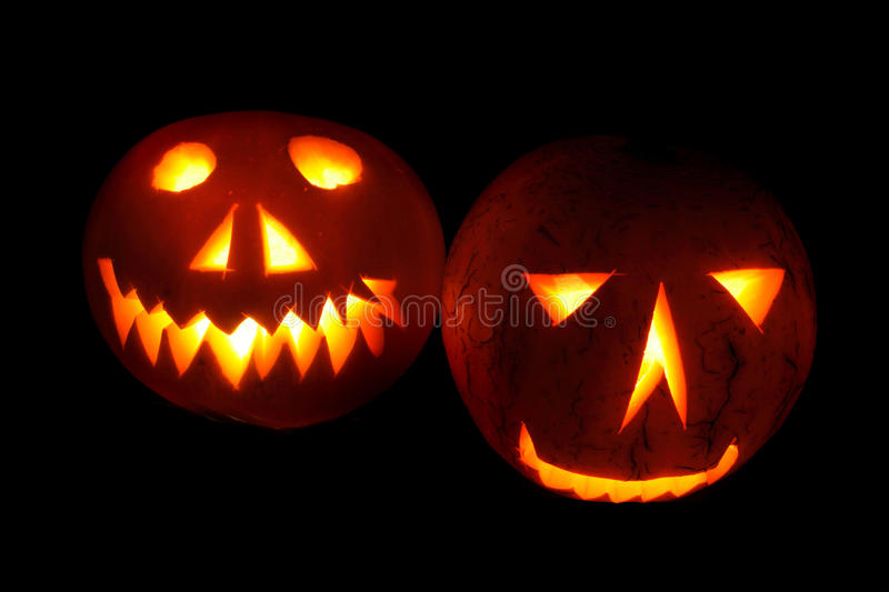 Halloween pumpkins in the night. Nice halloween pumpkins on the black background royalty free stock images