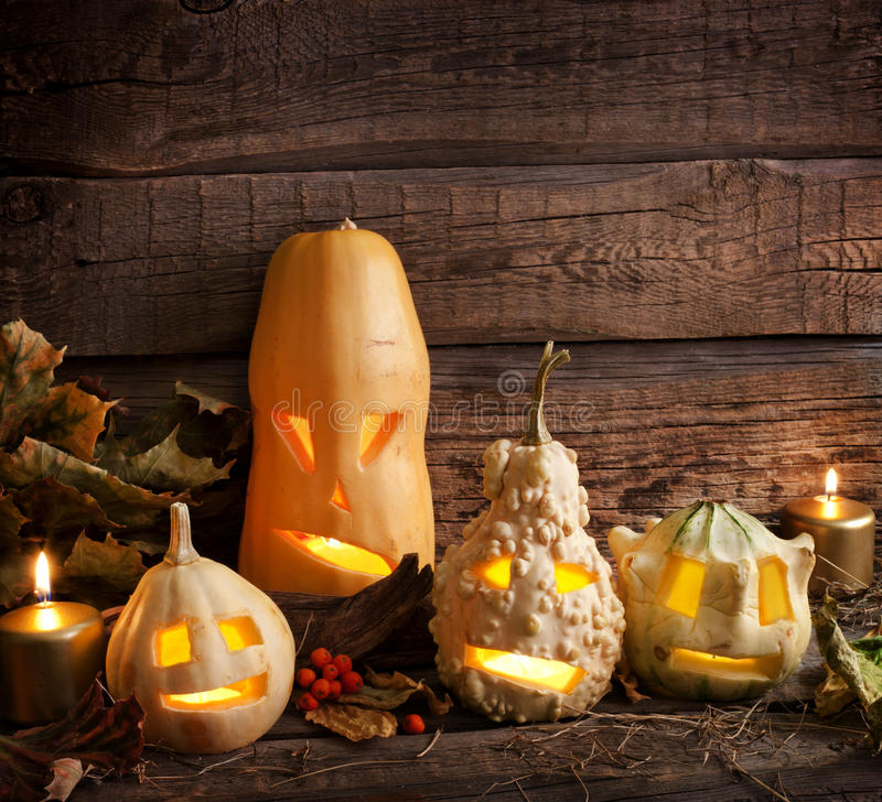 Halloween pumpkins in night. On wooden boards royalty free stock photos
