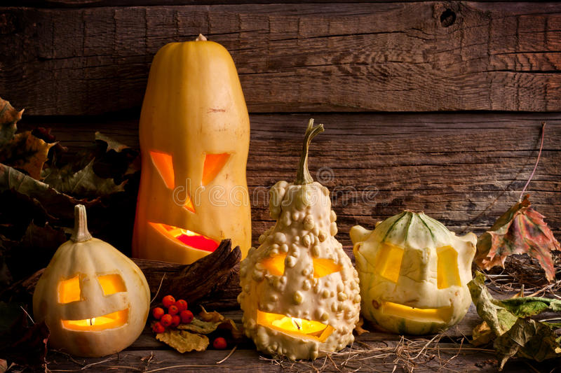 Halloween pumpkins in night. On wooden boards stock photography