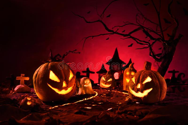 Halloween pumpkins of nightly spooky forest and Castle stock images