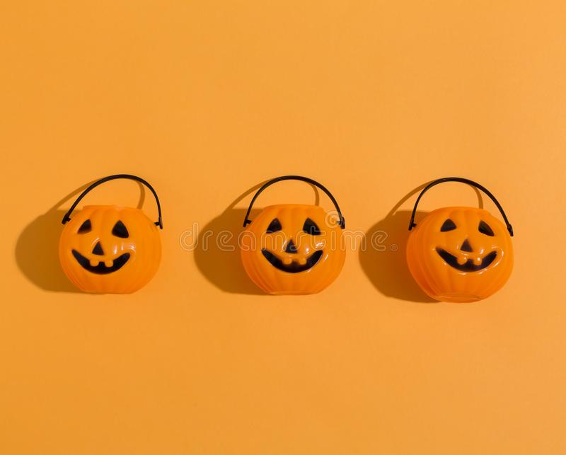 Halloween pumpkins overhead view. On a solid color royalty free stock photos