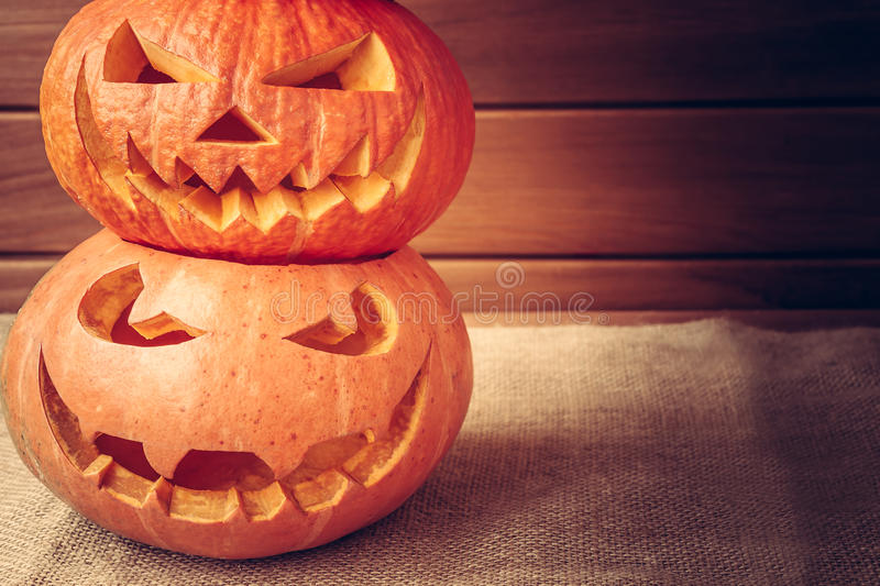 Halloween pumpkins pyramid on rustic background with copyspace stock image