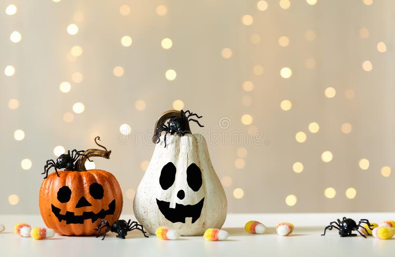 Halloween pumpkins with spider. On a shiny light background stock photography