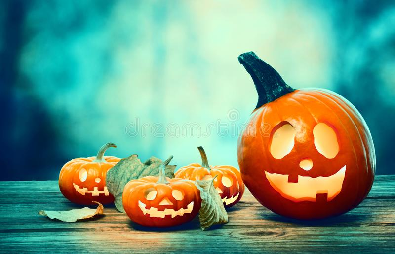 Halloween pumpkins at night. Halloween pumpkins on a spooky forest at night stock photo