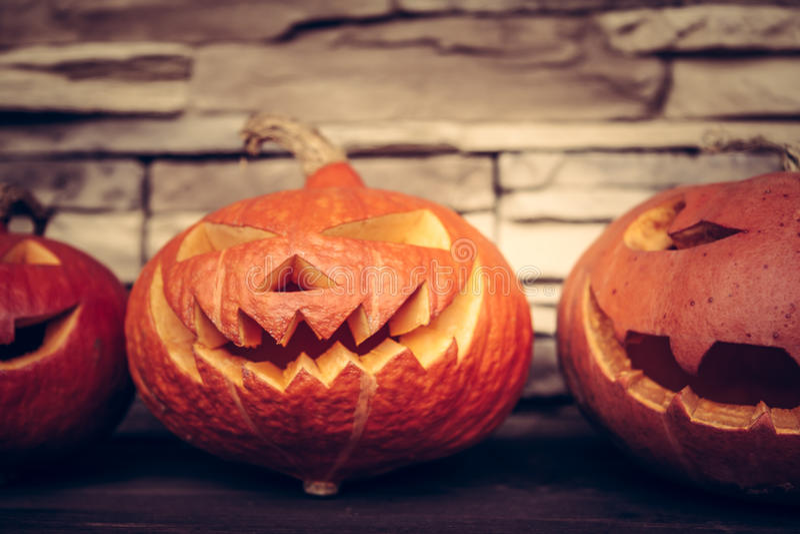 Halloween pumpkins on stone background. Halloween spooky pumpkins on stone background royalty free stock photography