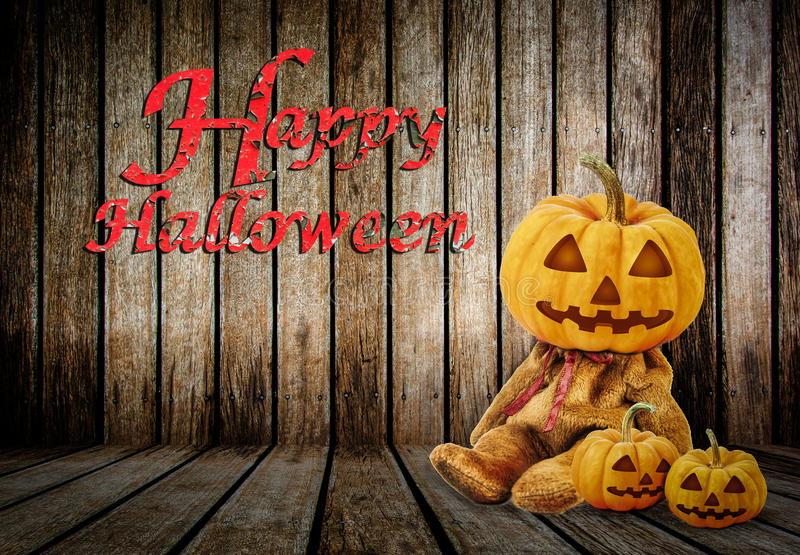 Halloween Pumpkins on wood background with message 'Happy Halloween'.  royalty free stock photo