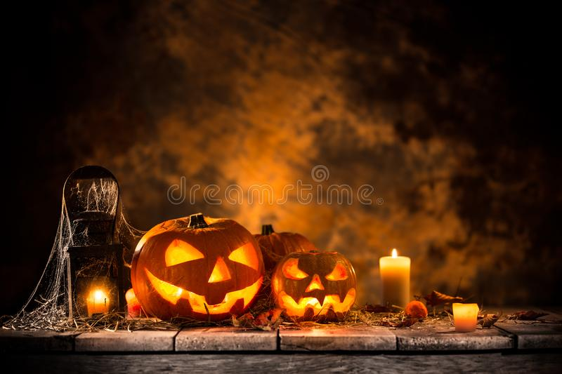 Halloween pumpkins on wooden planks. royalty free stock images