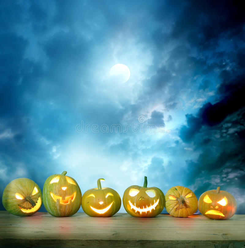 Halloween pumpkins on a wooden table royalty free illustration