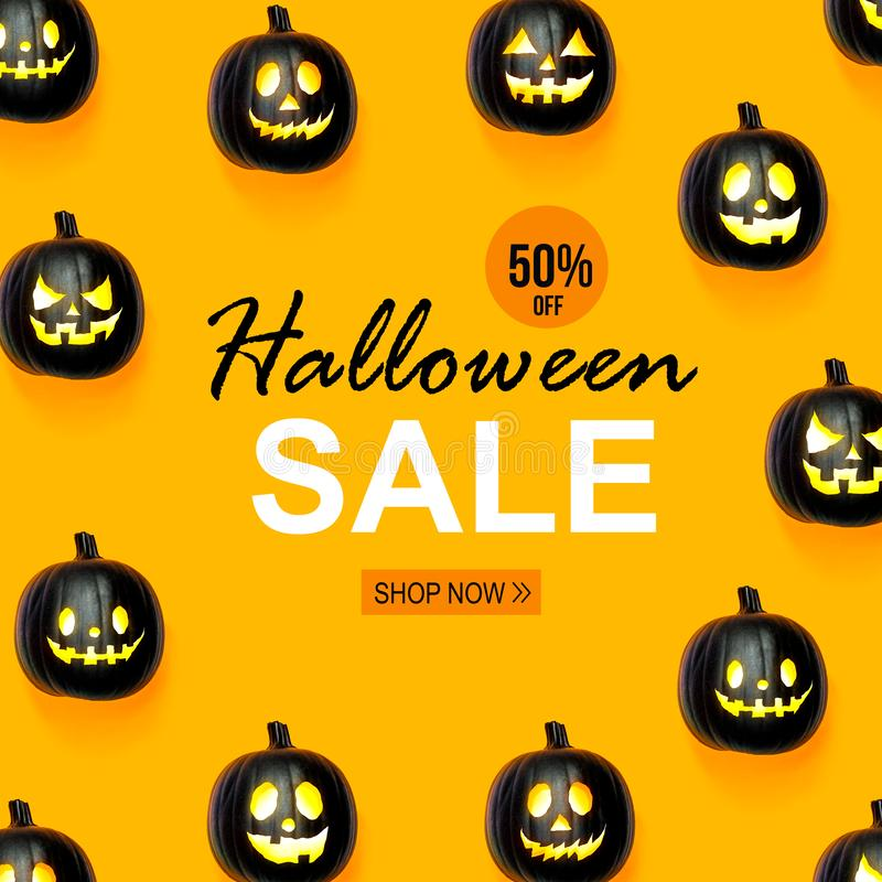 Halloween sale with black pumpkins. Halloween sale with black colored pumpkin lanterns royalty free stock photo