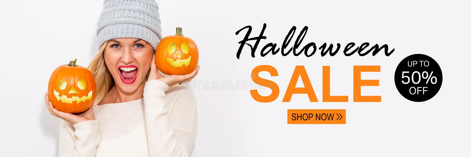 Halloween sale with woman holding pumpkins royalty free stock photo