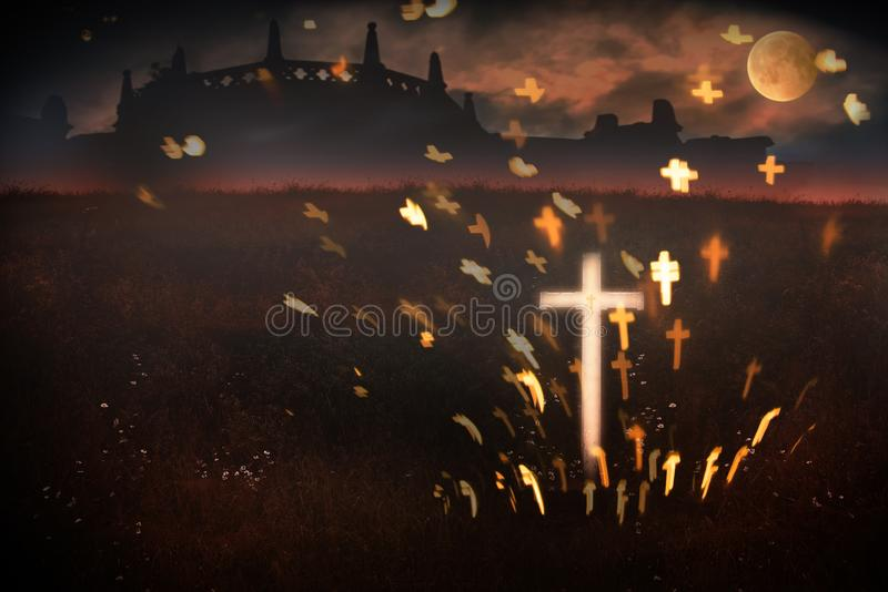 Halloween scene in twilight with crucifix. Halloween fantasy scene in twilight with moonlight and crucifix stock photo