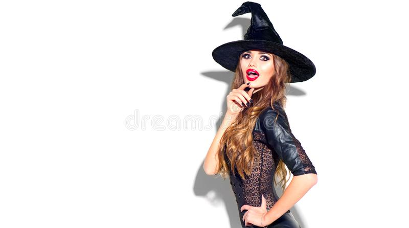 halloween Seksowna czarownica z jaskrawym wakacyjnym makeup Piękna zdziwiona młoda kobieta pozuje w czarownica seksownym kostiumu fotografia royalty free