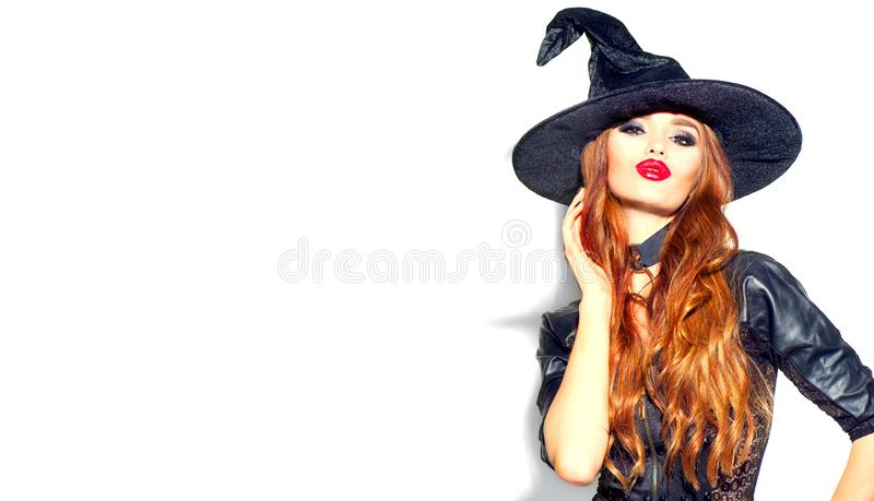 Halloween Sexy Girl wearing witch costume with a hat. Party, Celebrating. Beauty Woman with long hair and holiday bright makeup royalty free stock image