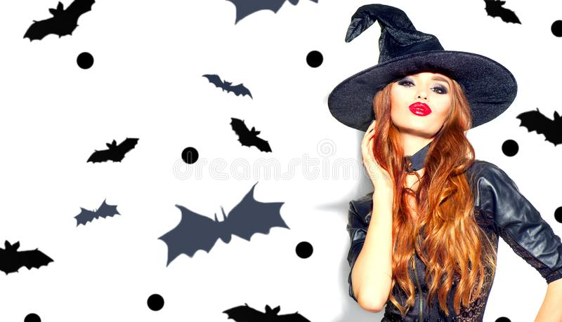 Halloween Sexy Girl wearing witch costume with a hat. Party, Celebrating. Beauty Woman with long hair and holiday bright makeup stock image