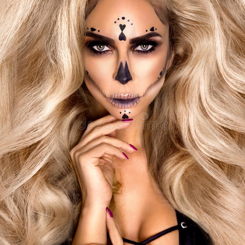 Halloween Sexy naked Witch portrait. Beautiful young woman in witches makeup with long curly colorful hair and sexy lingerie. Wide royalty free stock photo