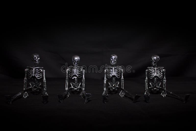 Halloween skeletons on black background royalty free stock photo