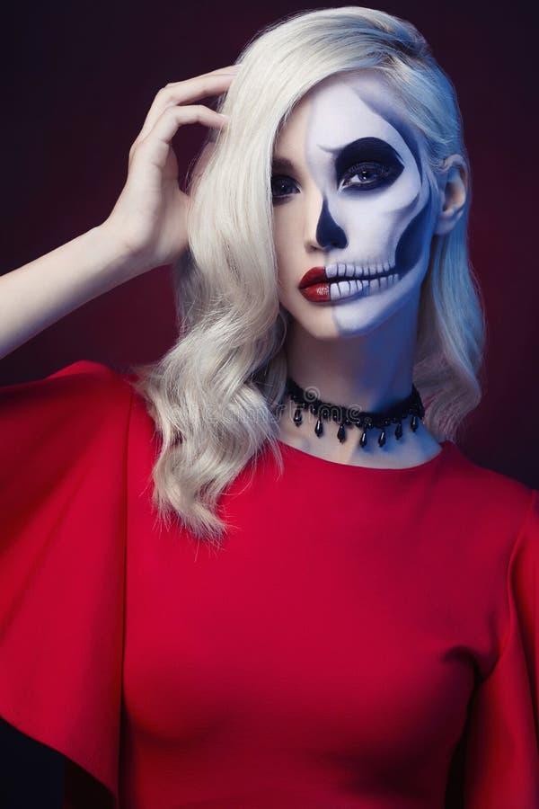 Halloween skull make-up beautiful woman royalty free stock image