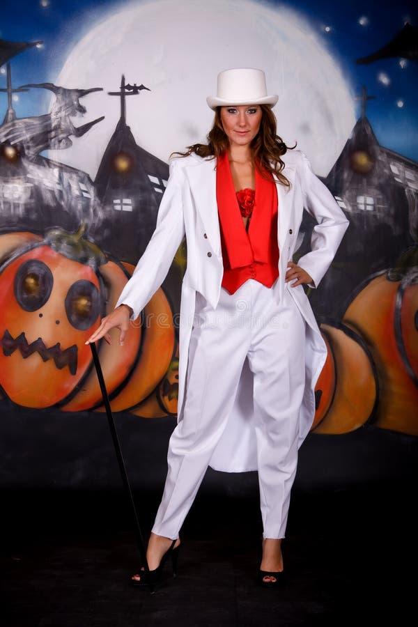 Halloween smoking woman. Young Halloweensmoking woman. Studio shot, painted themed background royalty free stock image