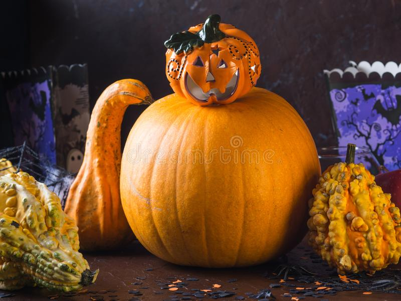 Halloween squash and candle. Decorations. Halloween squash and candle. Spider net. Holiday spooky decorations background still life stock photos