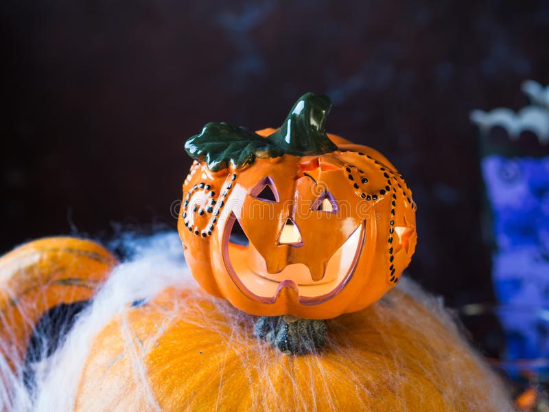 Halloween squash and candle. Spider net. Holiday spooky background still life royalty free stock photography