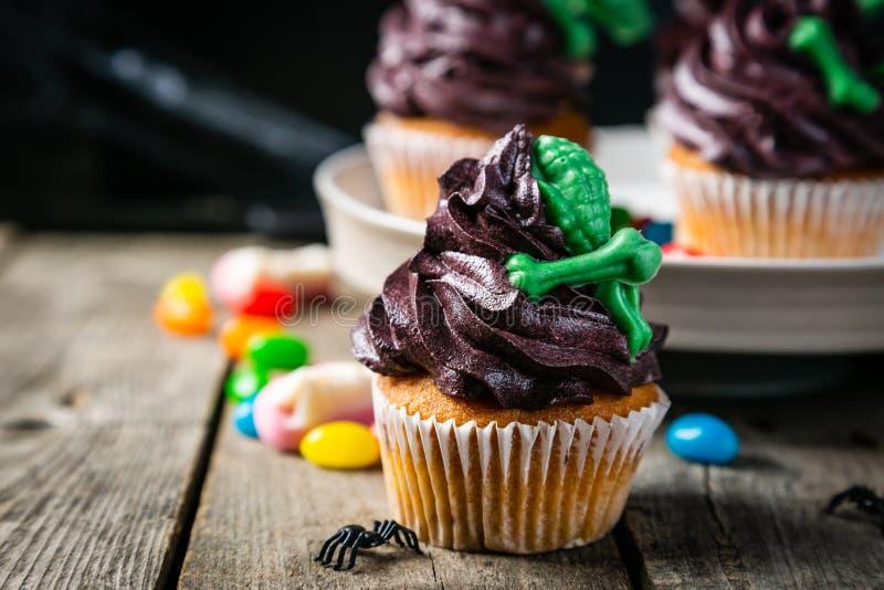 Halloween-stijlsnoepjes - cupcakes royalty-vrije stock afbeeldingen