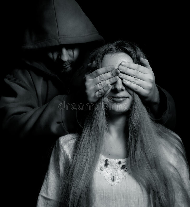 Download Halloween Surprise - Evil Man Behind Innocent Girl Stock Image - Image: 15963689