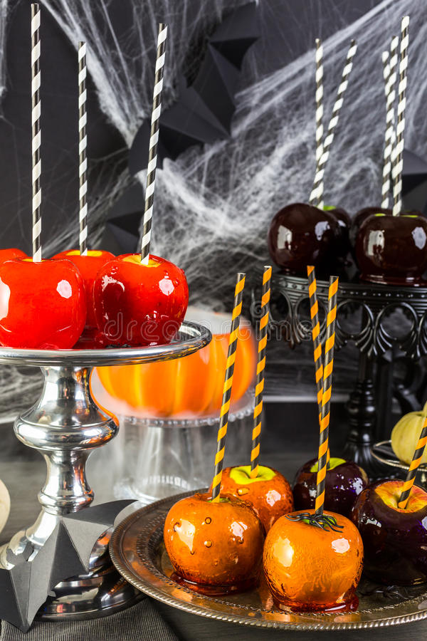 Halloween. Table with colored candy apples for Halloween party royalty free stock photos