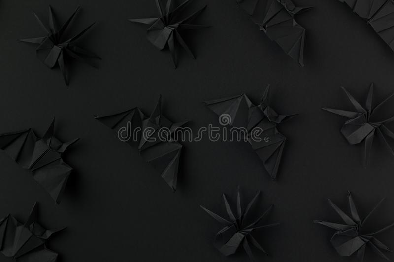 halloween texture with black origami bats and spiders stock image