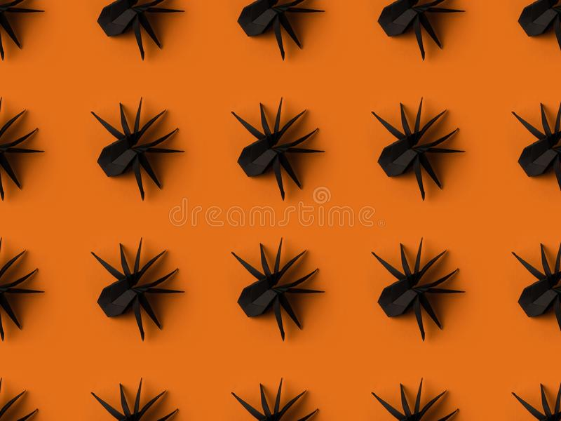 halloween texture with black origami spiders stock photography