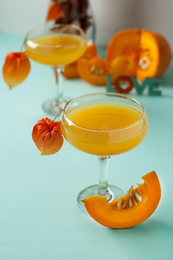 Halloween, Thanksgiving. Traditional autumn, winter drinks and cocktails. Spicy hot pumpkin drink, Selective focus, vertical. royalty free stock photography