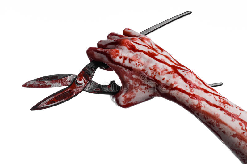 Halloween theme: bloody hand holding a big old bloody scissors on a white background stock photography