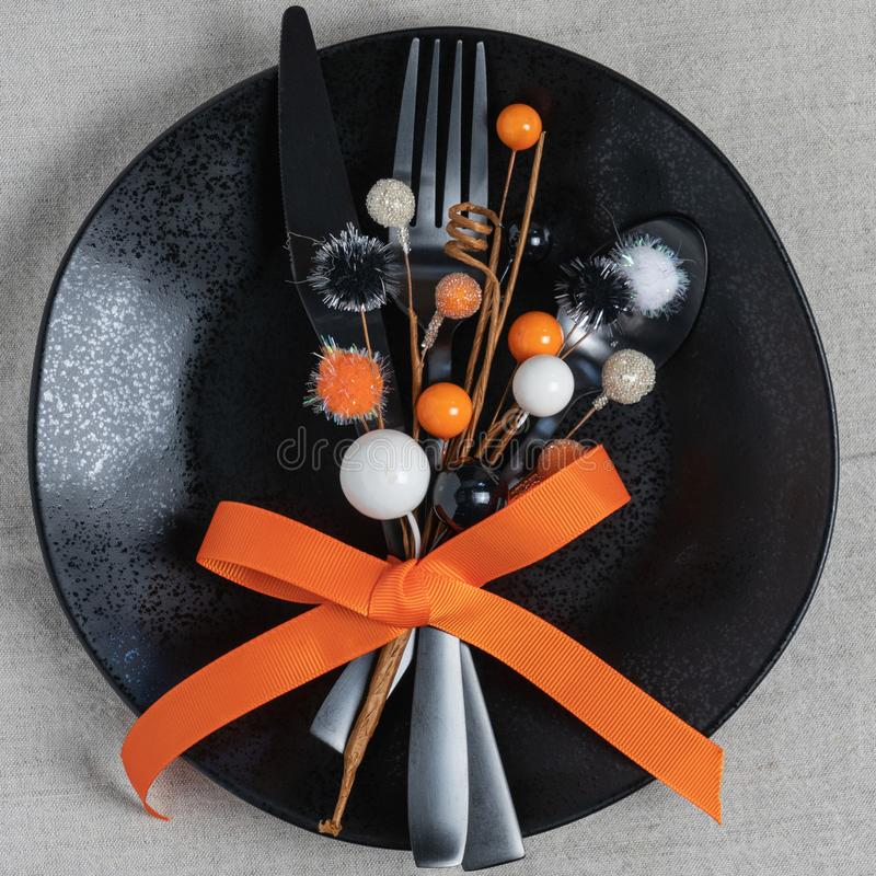 Halloween theme orange and black place setting royalty free stock images