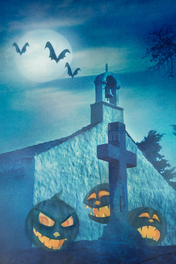 Halloween theme with pumpkins at graveyard royalty free stock photo
