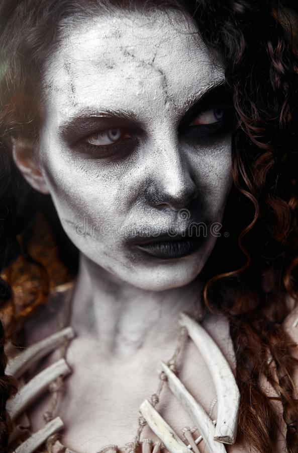 Halloween theme: scary sullen voodoo witch. Close-up portrait of evil hag. Zombie woman undead royalty free stock photos
