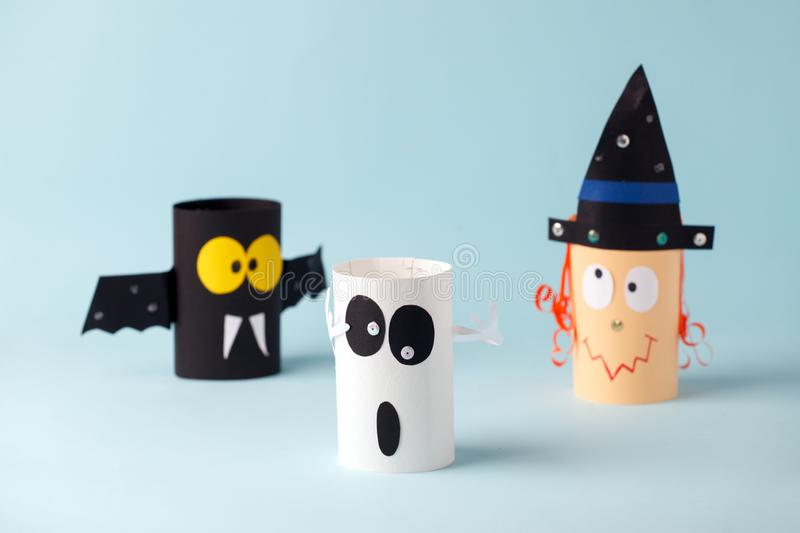 Halloween toy collection ghost, bat, witch on blue for Halloween concept background. Paper crafts, DIY. Handcraft creative idea. Fron toilet tube, recycle royalty free stock photos