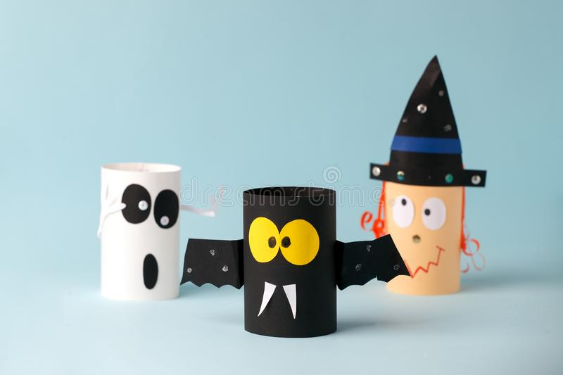 Halloween toy collection ghost, bat, witch on blue for Halloween concept background. Paper crafts, DIY. Handcraft creative idea. Fron toilet tube, recycle stock photos
