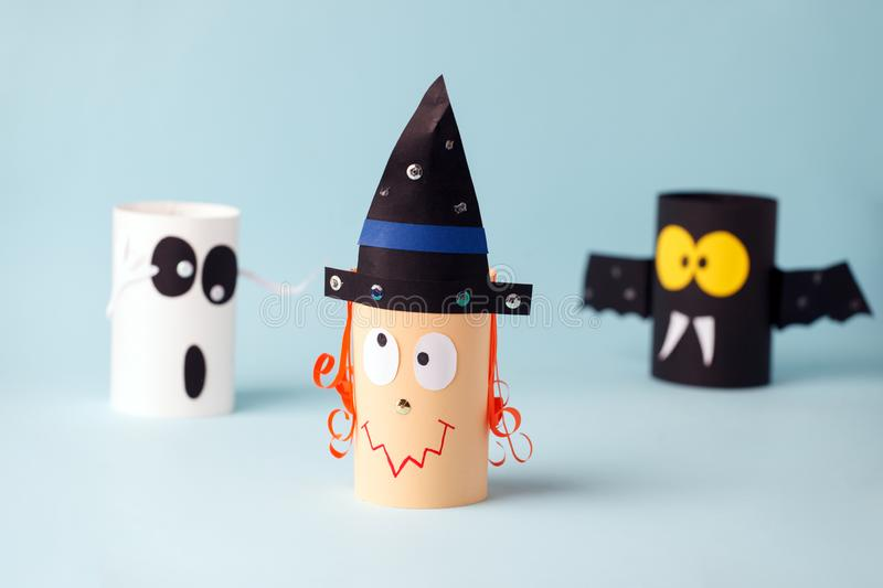 Halloween toy collection ghost, bat, witch on blue for Halloween concept background. Paper crafts, DIY. Handcraft creative idea. Fron toilet tube, recycle stock images
