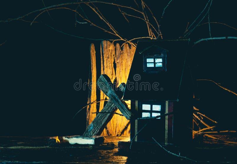 Halloween toy creepy black house with dark background. royalty free stock photo