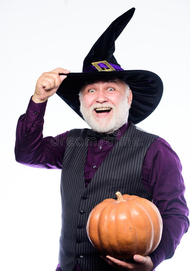 Halloween traditions. evil wizard hold orange pumpkin. bearded man ready for halloween party. Stargazer in holiday stock image