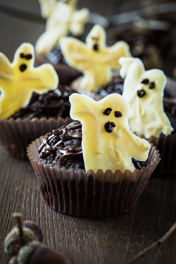 Halloween treats, chocolate muffins with sweet white chocolate stock photos