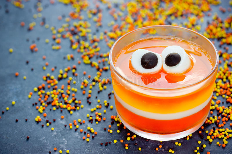 Halloween treats, little monster dessert with orange yellow and royalty free stock photos