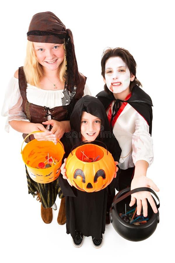 Halloween Trick oder Treaters getrennt stockbilder