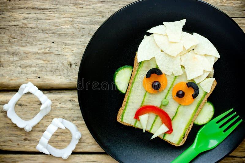 Halloween vampire sandwich for kids. Vegetable potato chips sandwich shaped sad vampire face royalty free stock images
