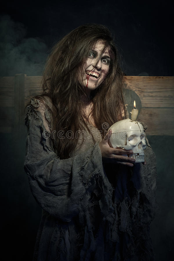 Halloween. The vampire with a skull in hands. Halloween. The Middle Ages. The vampire with a skull in hands royalty free stock photography